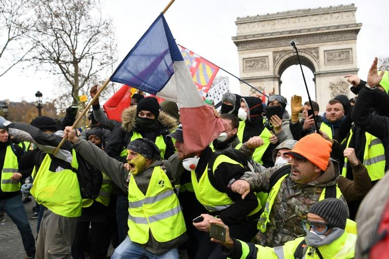 What began as demonstrations against fuel tax hikes have ballooned into a mass movement over rising living costs and accusations that Macron, an ex-banker, only looks out for the rich