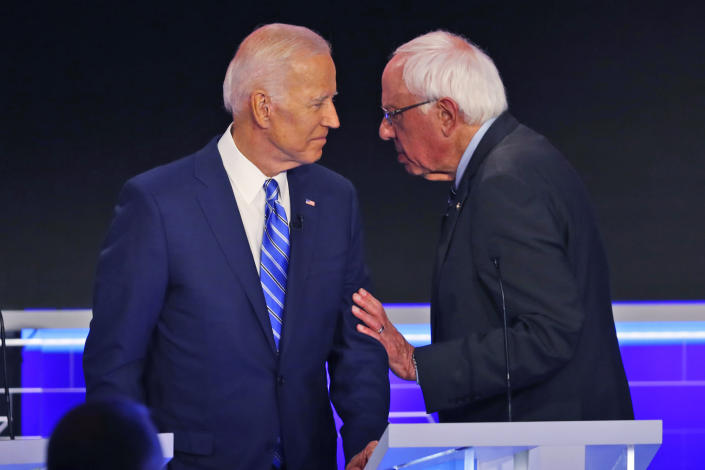 Democratic presidential candidate Sen. Bernie Sanders, I-Vt.., speaks to former vice president Joe Biden during a break in the Democratic primary debate hosted by NBC News at the Adrienne Arsht Center for the Performing Arts, Thursday, June 27, 2019, in Miami. (AP Photo/Wilfredo Lee)