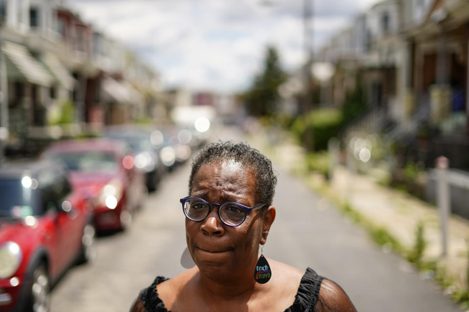 In this July 9, 2021 photo, Michelle Bolling poses for a photograph outside of her home in Philadelphia. Bolling's son is one of the increasing numbers of nonfatal gun violence victims. Homicide rates in many American cities have continued to rise although not as precipitously as the double-digit jumps seen in 2020 and still below the violence of the mid-90s. (AP Photo/Matt Rourke)