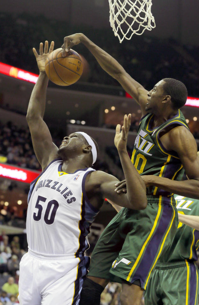 Utah Jazz's Jeremy Evans, right, slaps the ball away from Memphis Grizzlies' Zach Randolph (50) in the first half of an NBA basketball game in Memphis, Tenn., Monday, Dec. 23, 2013. (AP Photo/Danny Johnston)