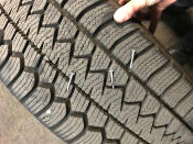 In this photo released Saturday, Aug. 8, 2020, by the Portland Police Department is a police vehicle tire that suffered damage from nail punctures, that authorities said was caused by a pool noodle filled with nails placed on a roadway to damage police vehicle tires during demonstrations in Portland, Ore. Violent protests have often roiled Oregon's largest city for more than two months since George Floyd was killed in Minneapolis. (Portland Police Department via AP)