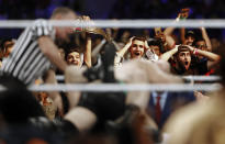 In this Thursday, Oct. 31, 2019 photo, Saudi fans shout during a wrestling match of the WWE Crown Jewel matches at King Fahd International Stadium in Riyadh, Saudi Arabia. Prince Abdulaziz bin Turki al-Faisal, who leads the General Sports Authority, said during an interview with the Associated Press that he invites anyone who's interested or curious about Saudi Arabia to come and visit the country after it opened tourist visas to people from around the world three months ago. (AP Photo/Amr Nabil)