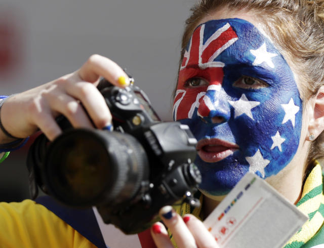 An Australian fan takes photos before the start of during the group B World Cup soccer match between Australia and the Netherlands at the Estadio Beira-Rio in Porto Alegre, Brazil, Wednesday, June 18, 2014. (AP Photo/Fernando Vergara)