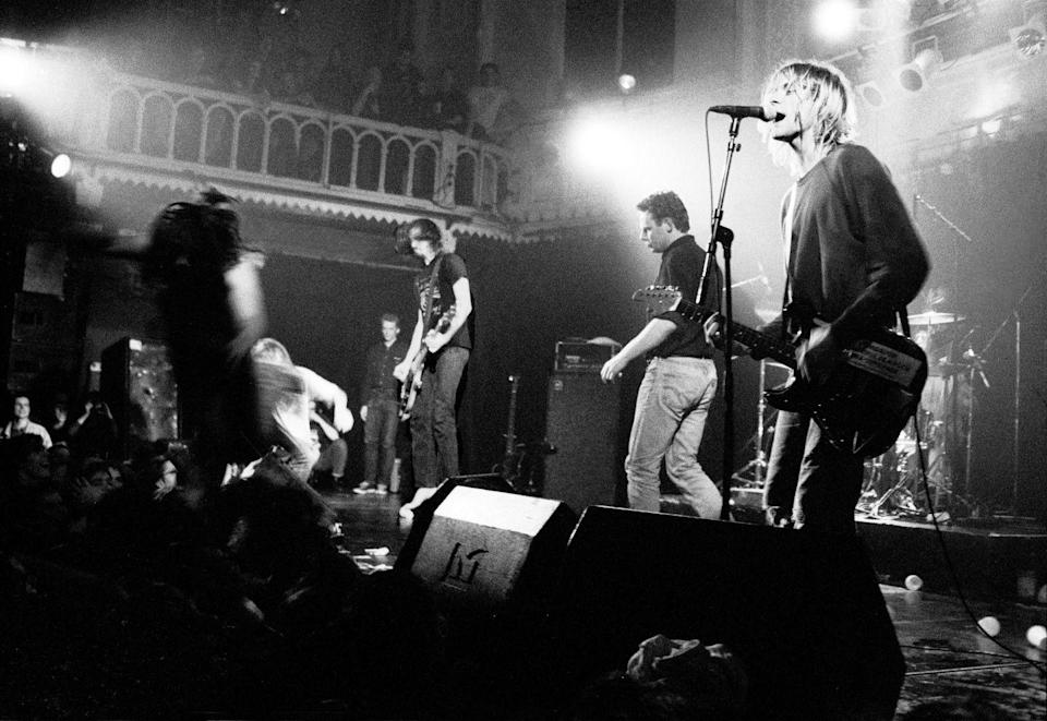 <p>Kurt Cobain sings into the mic during the band's performance at Paradiso in Amsterdam on November 25, 1991. </p>