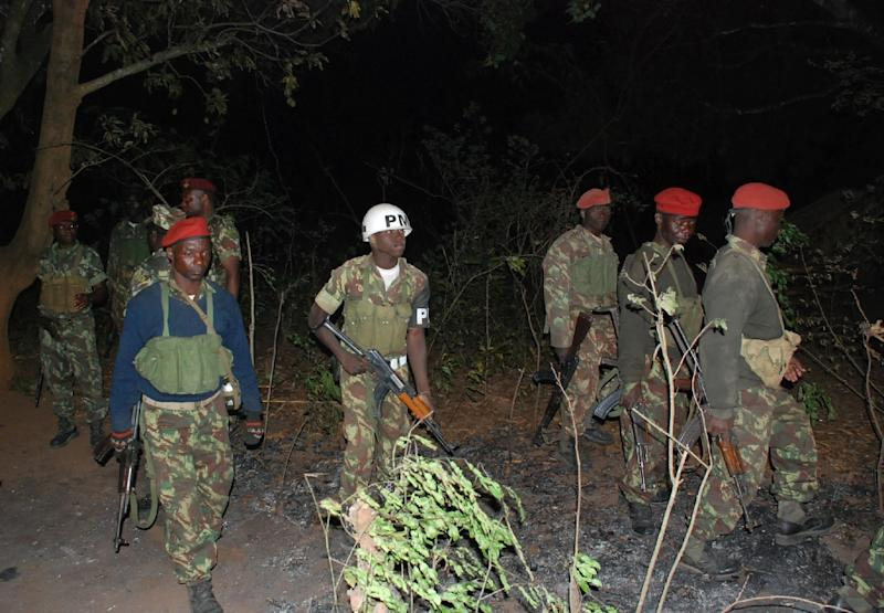 A picture taken on October 17, 2013 shows Mozambican government soldiers patrolling an area in Gorongosa (AFP Photo/Maria Celeste Mac'Arthur)
