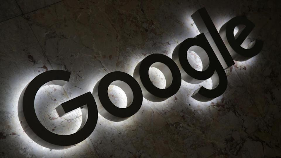 A Google logo is displayed at the entrance to the internet based company's office. Image: Reuters.