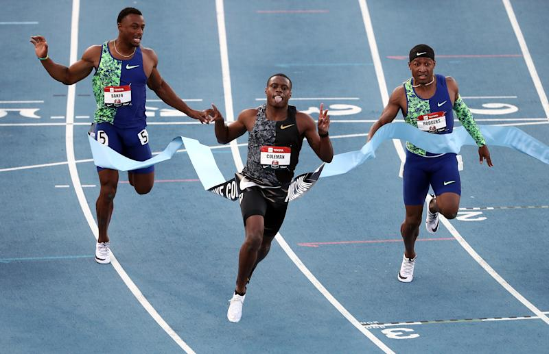 Christian Coleman, center, crosses the finish line to win the men's 100-meter final during the 2019 USATF Outdoor Championships at Drake Stadium in Des Moines, Iowa, last month.