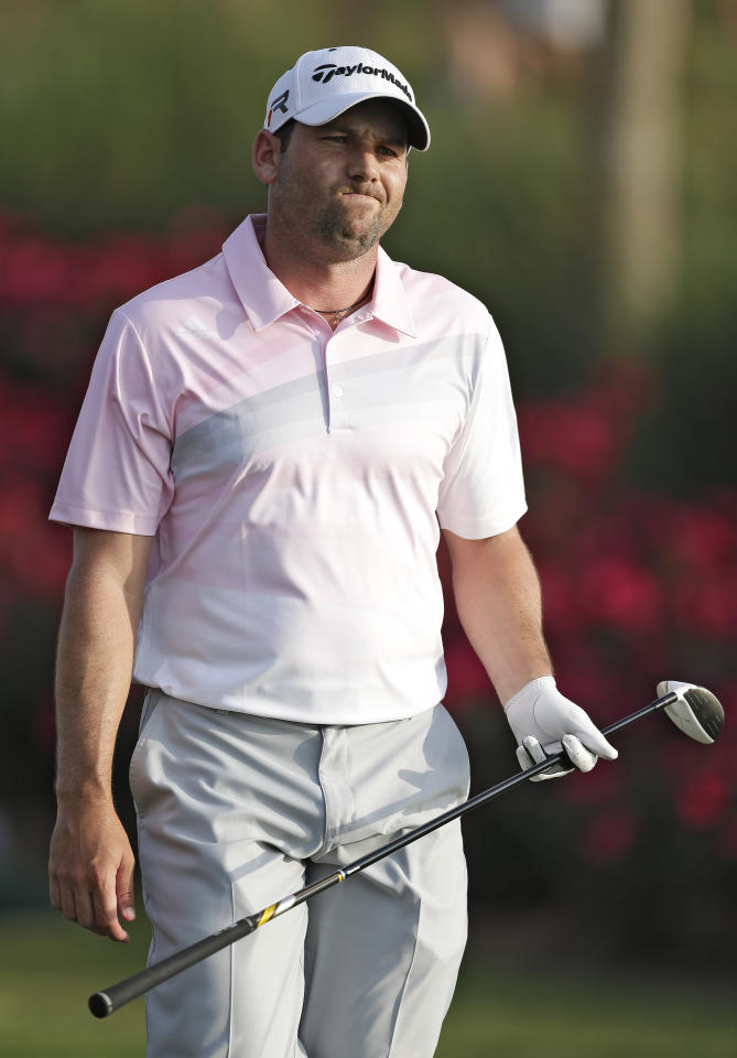 Sergio Garcia, of Spain, reacts after his tee shot on the 18th hole went into the water during the final round of The Players Championship golf tournament at TPC Sawgrass, Sunday, May 12, 2013, in Ponte Vedra Beach, Fla. (AP Photo/Chris O'Meara)