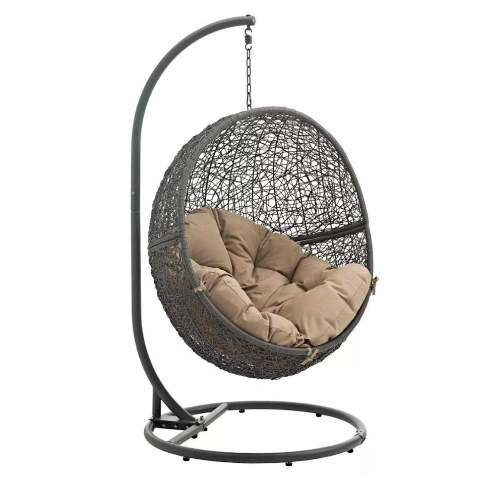 "This hanging, egg-shaped chair is billed as patio furniture, but we'd set it up indoors—preferably next to a window—to create the coziest nest for <a href=""https://www.glamour.com/about/books?mbid=synd_yahoo_rss"" rel=""nofollow noopener"" target=""_blank"" data-ylk=""slk:book"" class=""link rapid-noclick-resp"">book</a> reading, snowflake watching, and mulled cider sipping. $581, Target. <a href=""https://www.target.com/p/hide-outdoor-patio-swing-chair-modway/-/A-52387617"" rel=""nofollow noopener"" target=""_blank"" data-ylk=""slk:Get it now!"" class=""link rapid-noclick-resp"">Get it now!</a>"