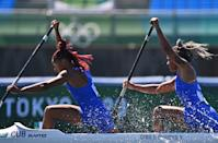 <p>Cuba's Yarisleidis Cirilo Duboys (L) and Cuba's Katherin Nuevo Segura compete in a heat of the women's canoe double 500m event during the Tokyo 2020 Olympic Games at Sea Forest Waterway in Tokyo on August 6, 2021. (Photo by Philip FONG / AFP)</p>