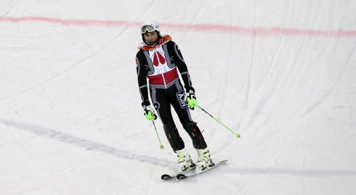 Mexico's Hubertus von Hohenlohe reacts after crashing during the first run of the men's slalom at the Sochi 2014 Winter Olympics, Saturday, Feb. 22, 2014, in Krasnaya Polyana, Russia.(AP Photo/Gero Breloer)