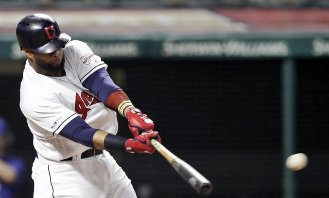 Cleveland Indians' Carlos Santana hits a double in the fourth inning in a baseball game against the Kansas City Royals, Monday, June 24, 2019, in Cleveland. (AP Photo/Tony Dejak)