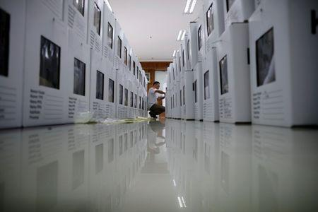 A man prepares election materials to be distributed to polling stations in Jakarta, Indonesia April 16, 2019. REUTERS/Edgar Su