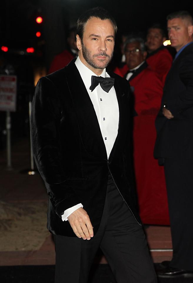 New dad Tom Ford took a night off from diaper duties to attend the bash. As usual the fashion designer looked completely debonair in his tailored tux. (10/26/12)<br>