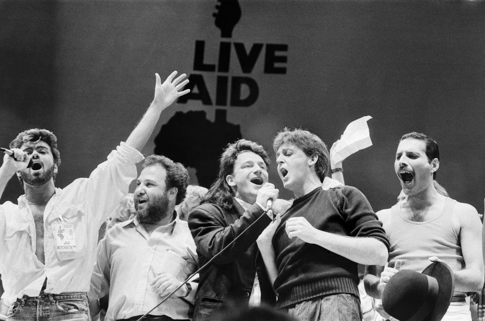 George Michael, promoter Harvey Goldsmith, Bono, Paul McCartney, and Freddie Mercury during the Live Aid finale in London. (Photo: Staff/Daily Mirror/Mirrorpix/Getty Images)