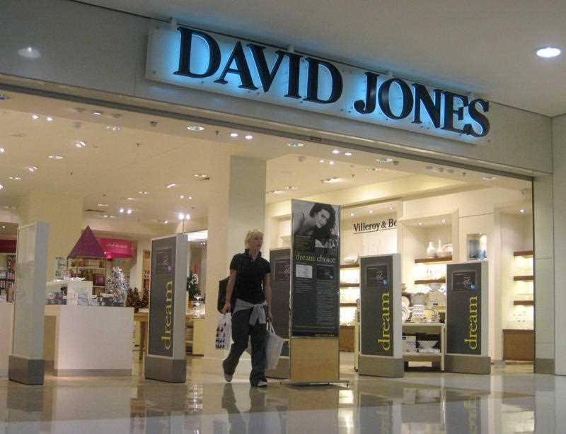 A customer leaves a David Jones department store in the Westfield shopping centre in Bondi Junction.