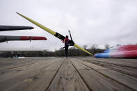 Rower Gevvie Stone prepares to launch her boat at Lady Bird Lake ahead of the upcoming U.S. Olympic rowing trials, Friday, Feb. 12, 2021, in Austin, Texas. (AP Photo/Eric Gay)