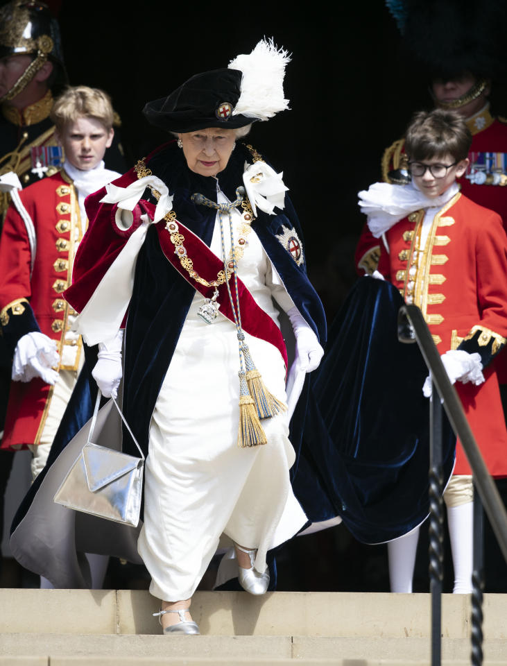 <p>The Queen pulled out all the stops when she arrived at the Order of the Garter ceremony, wearing a white dress, blue velvet robes and a feathered hat. Photo: Getty Images </p>