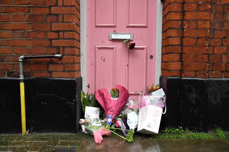 Floral tributes placed outside Caroline Flack's former home in North London.