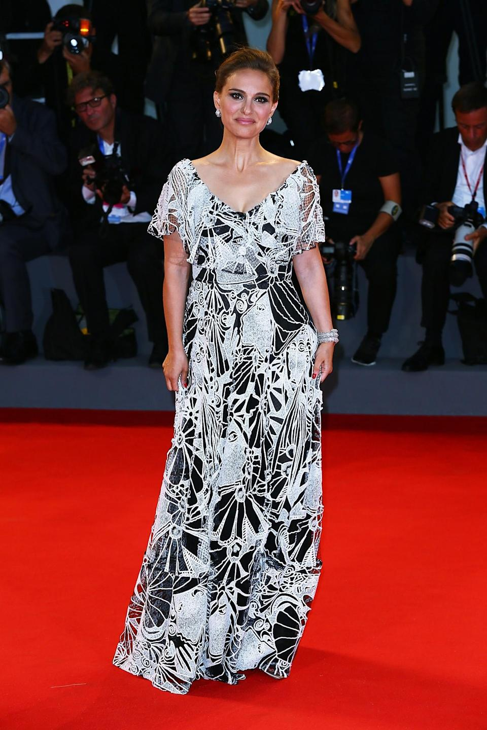 <p>A patterned Valentino dress disguised the star's baby bump at the 'Jackie' premiere in Venice. [Photo: Getty] </p>
