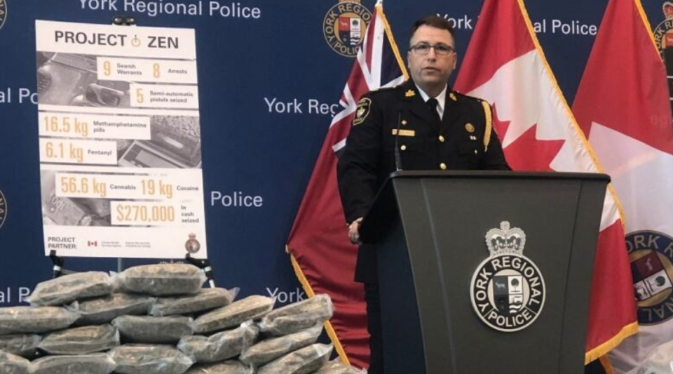 York Regional Police Supt. Michael Slack speaks in front of some of the drugs and handguns seized in two major drug investigations in the GTA.