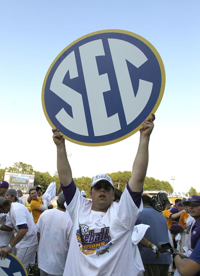 LSU's Alden Cartwright (32) holds up the SEC sign after they defeated Florida 2-0 at the Southeastern Conference NCAA college baseball tournament on Sunday, May 25, 2014, in Hoover, Ala. (AP Photo/Butch Dill)