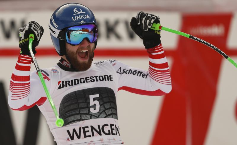 Austria's Marco Schwarz celebrates in the finish area after winning an alpine ski, men's World Cup combined in Wengen, Switzerland, Friday, Jan. 18, 2019. (AP Photo/Gabriele Facciotti)