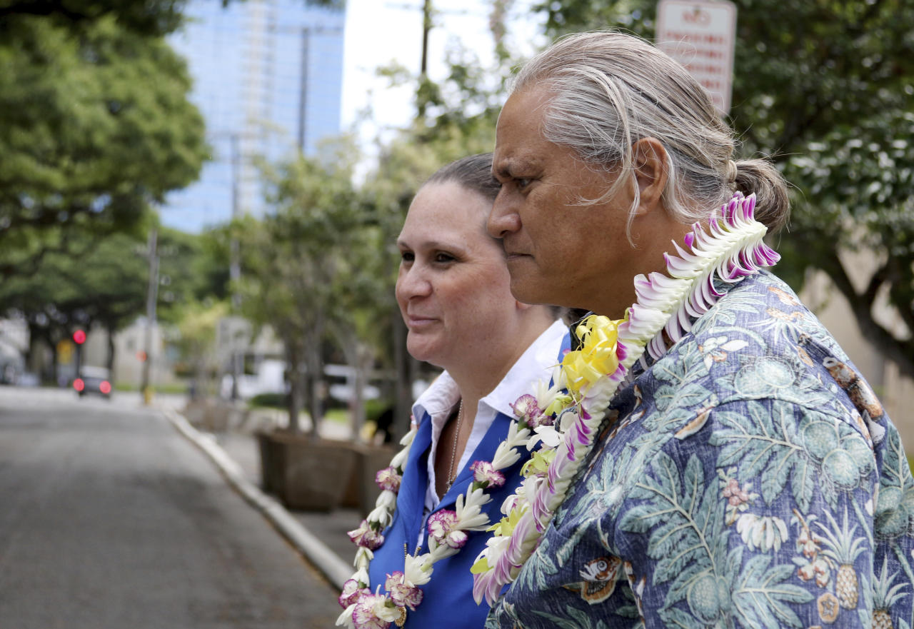 Former Honolulu Police Chief Louis Kealoha, right, and his wife, Katherine Keahola leave federal court in Honolulu, Friday, Oct. 20, 2017. Kealoha and his wife, a city prosecutor, have pleaded not guilty to federal corruption charges. U.S. Magistrate Judge Richard Puglisi on Friday released Louis and Katherine Keahola on $100,000 bond each. They entered the pleas Friday after a federal grand jury indicted both of them in a public corruption case. Authorities claim the couple used their positions to bilk clients and relatives out of hundreds of thousands of dollars to fund their lavish and overextended lifestyle and then used their power to target anyone who threatened them. (AP Photo/Caleb Jones)