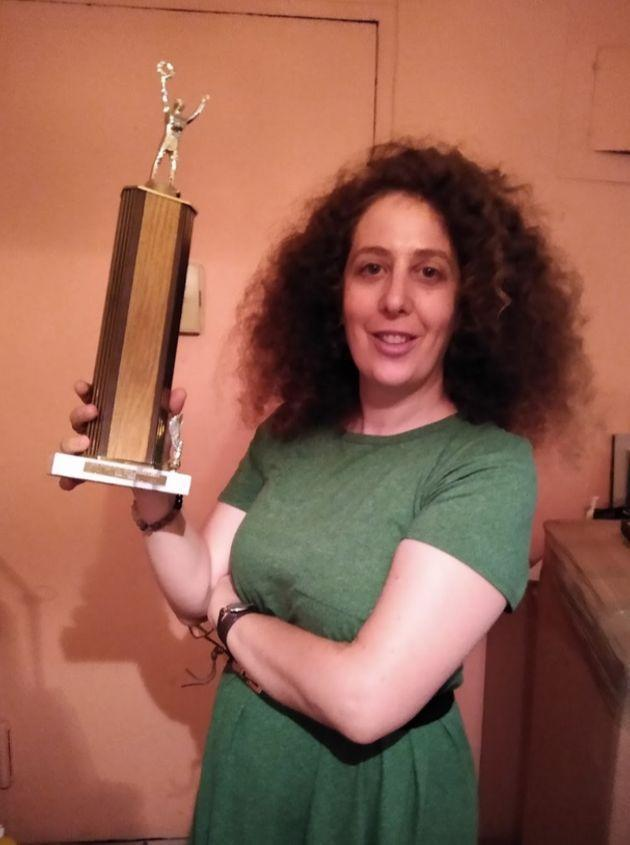 The author in September with her last remaining trophy, which her parents found when moving out of the East 23rd Street apartment. (Photo: Courtesy of Sari Caine)