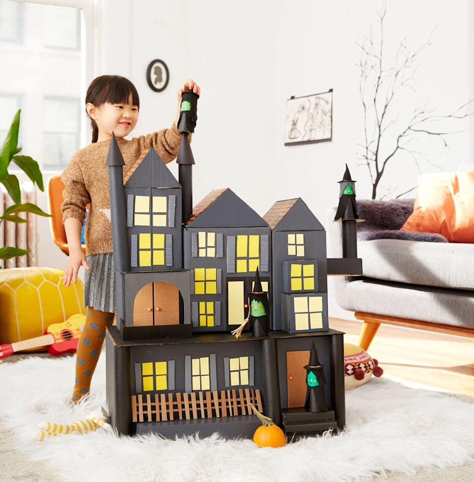 "<p>Put extra Amazon boxes to good use by transforming them into a multi-level haunted house. Give it a quick paint job, glue on doors and windows, and then let your kids play pretend. </p><p><em><a href=""https://projectkid.com/cardboard-haunted-house/"" rel=""nofollow noopener"" target=""_blank"" data-ylk=""slk:Get the tutorial at Project Kid »"" class=""link rapid-noclick-resp"">Get the tutorial at Project Kid »</a></em></p>"