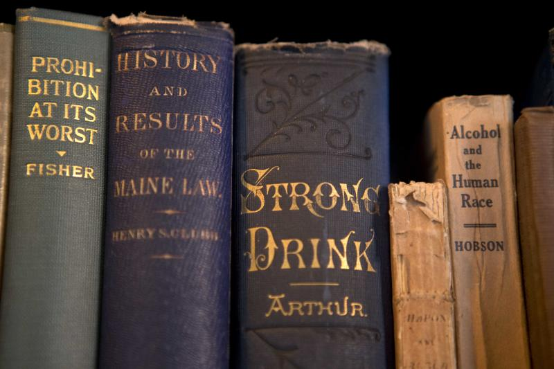 In this photo made Nov. 8, 2013, books dealing with alcohol and prohibition are seen in the library of the Neal Dow House in Portland, Maine. Neal Dow, a Union general, entrepreneur and teetotaling crusader, led the push as Maine became the first state to adopt a prohibition law. (AP Photo/Robert F. Bukaty)