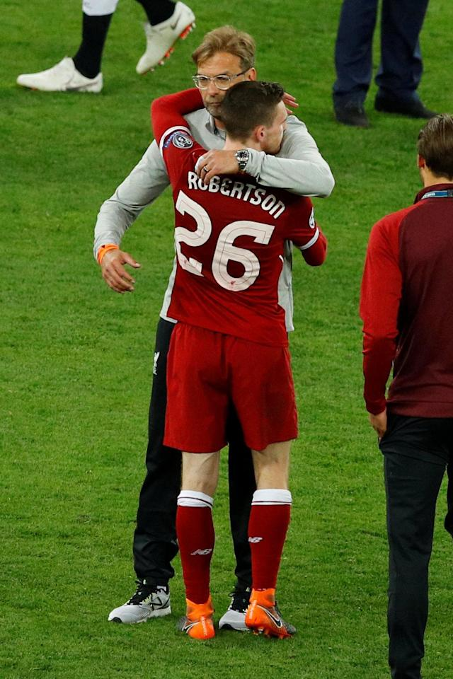 Soccer Football - Champions League Final - Real Madrid v Liverpool - NSC Olympic Stadium, Kiev, Ukraine - May 26, 2018 Liverpool manager Juergen Klopp is dejected with Andrew Robertson after losing the Champions League final REUTERS/Phil Noble