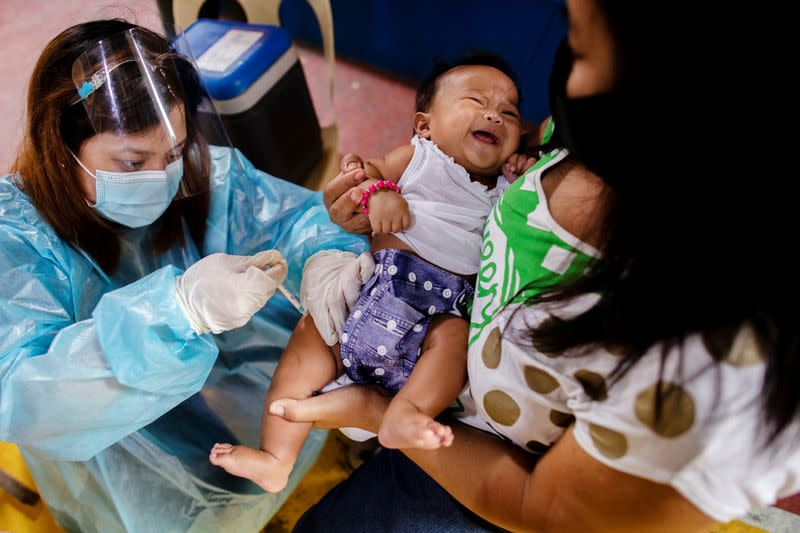 Ghosts of past vaccine deaths haunt Philippines' COVID-19 drive