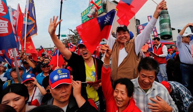 Supporters of KMT candidate Han Kuo-yu wave national flags during a rally in Yilan on Tuesday. Photo: Reuters