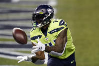 Seattle Seahawks wide receiver DK Metcalf catches a pass for a touchdown against the Arizona Cardinals, during the first half of an NFL football game, Thursday, Nov. 19, 2020, in Seattle. (AP Photo/Elaine Thompson)