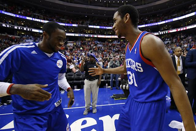 Philadelphia 76ers' Tony Wroten, left, and Hollis Thompson celebrate after an NBA basketball game against the Detroit Pistons, Saturday, March 29, 2014, in Philadelphia. Philadelphia won 123-98, breaking a 26-game losing streak. (AP Photo/Matt Slocum)