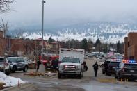 Police officers and an ambulance are seen at the scene where an active shooter was reported at a grocery store in Boulder