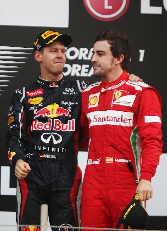 YEONGAM-GUN, SOUTH KOREA - OCTOBER 14:  Race winner Sebastian Vettel (L) of Germany and Red Bull Racing celebrates with third placed Fernando Alonso (R) of Spain and Ferrari on the podium following the Korean Formula One Grand Prix at the Korea International Circuit on October 14, 2012 in Yeongam-gun, South Korea.  (Photo by Mark Thompson/Getty Images)