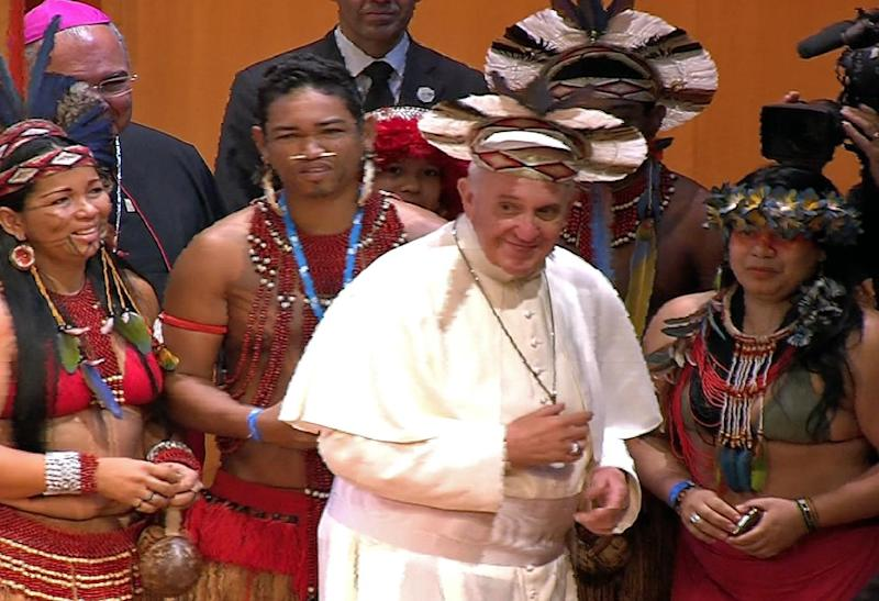 In this frame grab from video Pope Francis wears an indigenous feather hat given to him by representatives of one of Brazil's native tribes during a meeting at the Municipal Theater in Rio de Janeiro, Brazil, Saturday, July 27, 2013. Pope Francis is on the sixth day of his trip to Brazil where he will attend the 2013 World Youth Day in Rio. (AP Photo/TV Pool)