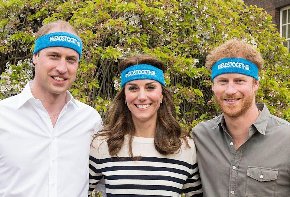 """<p>Royals Will, Kate, and Harry wore matching headbands supporting their <a href=""""https://www.townandcountrymag.com/society/tradition/a32768499/prince-william-kate-middleton-harry-heads-together-black-lives-matter/"""" rel=""""nofollow noopener"""" target=""""_blank"""" data-ylk=""""slk:Heads Together charity"""" class=""""link rapid-noclick-resp"""">Heads Together charity</a>, which promotes mental health awareness. The trio was photographed at Kensington Palace, with Kate wearing a cream and navy striped top. </p>"""