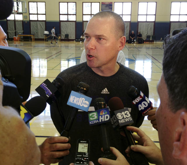 Sacramento Kings coach Mike Malone speaks with the media after the first practice of NBA basketball training camp on Tuesday, Oct. 1, 2013, in Santa Barbara, Calif. The Kings are hoping their successful summer leads to more victories this season with a new coaching staff, front office and ownership group. (AP Photo/Greg Beacham)
