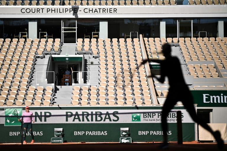 Players take part in a French Open warm-up session without spectators at Roland Garros