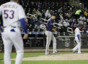 Minnesota Twins starting pitcher Jake Odorizzi (12) reacts after walking New York Mets' Noah Syndergaard to load the bases during the fifth inning of a baseball game Wednesday, April 10, 2019, in New York. (AP Photo/Frank Franklin II)