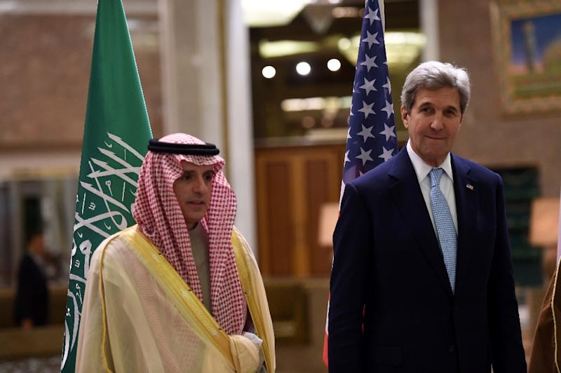 US Secretary of State John Kerry (R) talks to Saudi Minister of Foreign Affairs Adel al-Jubeir as they arrive for a family picture during a meeting of the Quartet on the situation in Yemen, on December 18, 2016 in Riyadh