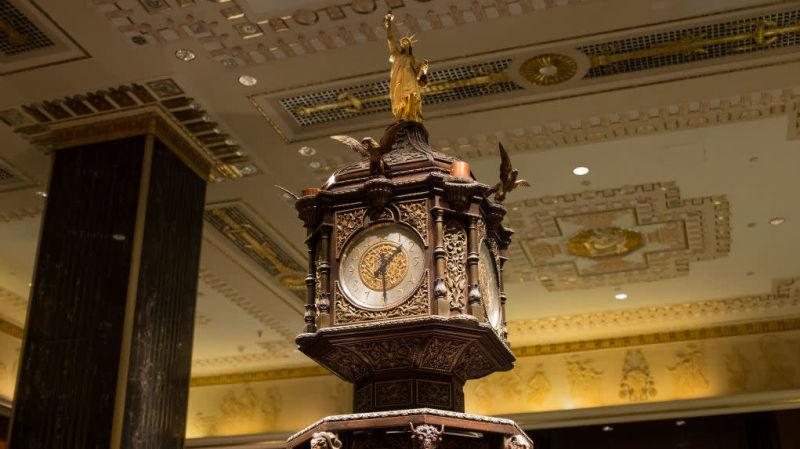 A glided statue of liberty sits atop the clock in the main lobby of of the Waldorf Astoria hotel on Park Avenue, Manhattan
