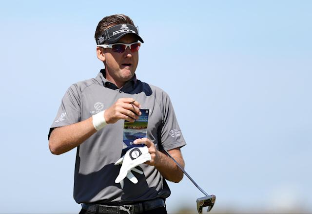 Ian Poulter of England prepares to putt on the 6th green during a practice round ahead of the British Open Golf championship at the Royal Liverpool golf club, Hoylake, England, Tuesday July 15, 2014. The British Open starts on Thursday July 17. (AP Photo/Scott Heppell)