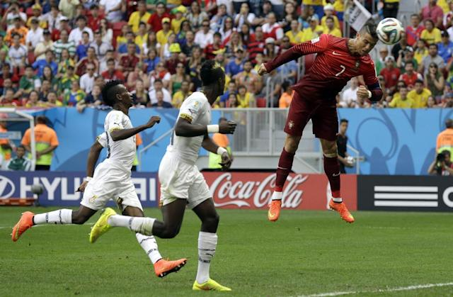 Portugal's Cristiano Ronaldo goes close with a header during the group G World Cup soccer match between Portugal and Ghana at the Estadio Nacional in Brasilia, Brazil, Thursday, June 26, 2014. (AP Photo/Martin Mejia)