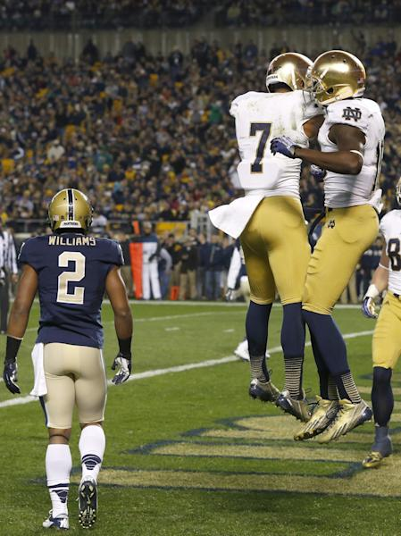 Notre Dame wide receiver DaVaris Daniels, right, celebrates with TJ Jones (7) after making a touchdown catch on Pittsburgh defensive back K'Waun Williams (2) in the first quarter of an NCAA college football game Saturday, Nov. 9, 2013, in Pittsburgh. (AP Photo/Keith Srakocic)
