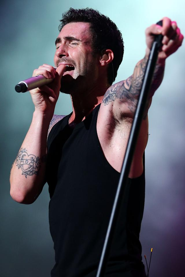 SINGAPORE - SEPTEMBER 22:  Adam Levine lead singer of Maroon 5 performs during the 2012 F1 Singapore on September 22, 2012 in Singapore.  (Photo by Chris McGrath/Getty Images)