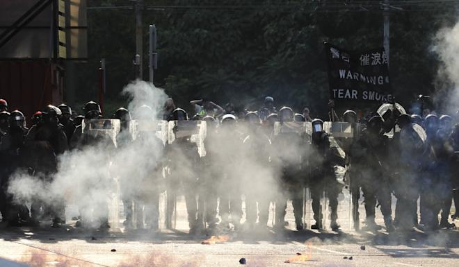 Police fire tear gas in immediate response to petrol bombs being thrown in Tuen Mun. Photo: Felix Wong